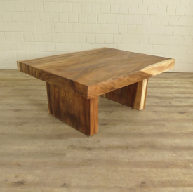 Coffee table made from teak wood tree trunks