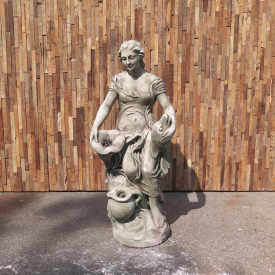 Concrete fountain of a woman with a fish